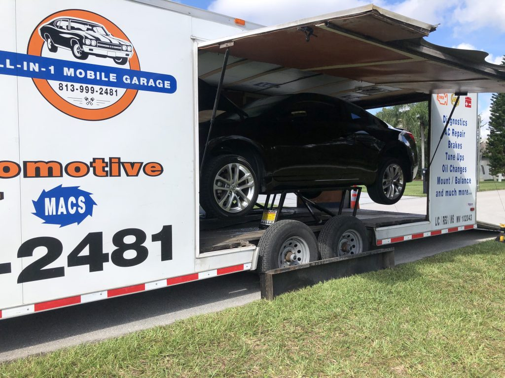 Mobile Automotive Service Wesley Chapel, Country Walk, Meadow Point. Tire Rotation being performed.